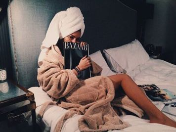 bundling up after a bath to read glossy mags in bed